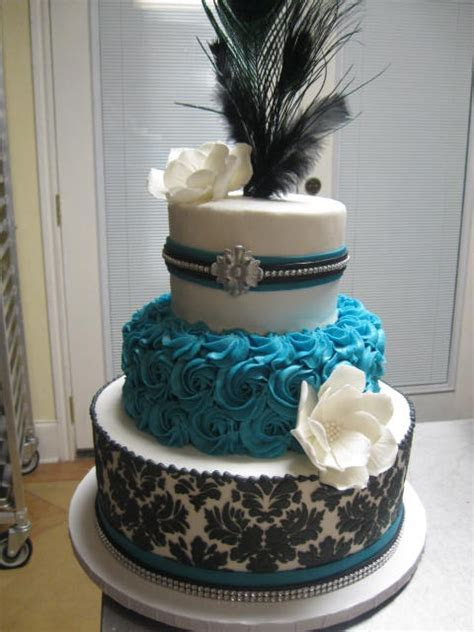 Turquoise and black rosette and damask wedding cake