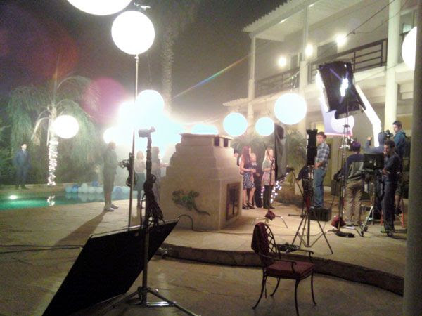 Filming a dinner party scene on the mansion's rear patio.