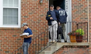 FBI agents leaving the home of Farooque Ahmed in Ashburn, Virginia