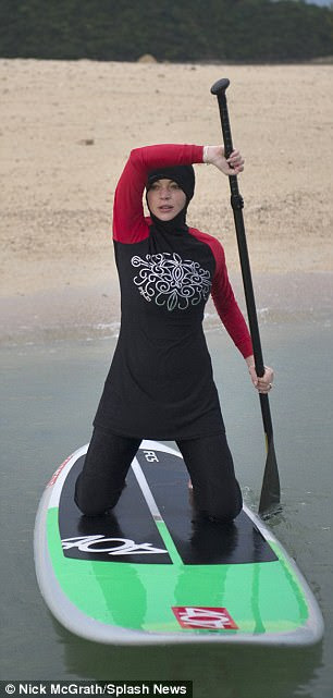 Wet and wild: Lindsay knelt on the paddleboard as she launched herself off into the waves
