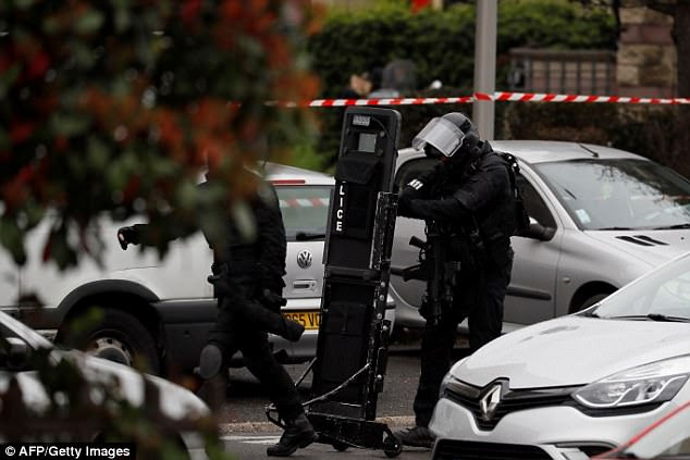 The apartment block where Ben Belgacem lived is being searched by police after this morning's shooting