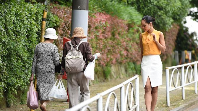 """""""In Japan there are hardly any black models or TV personalities,"""" says Miss Universe Japan Ariana Miyamoto (R)"""