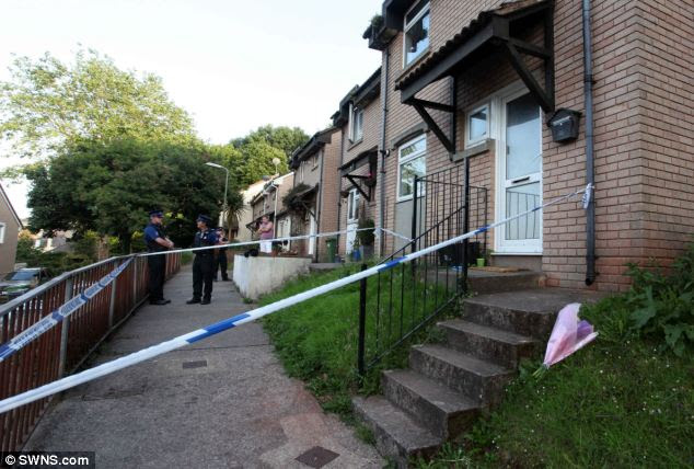Flowers: The house in Paignton, Devon, where the body of the two-year-old was found