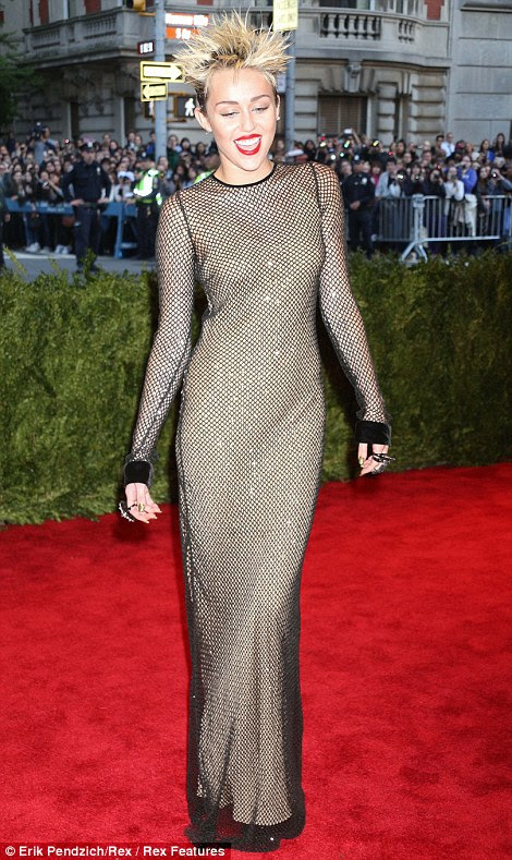 Sheer delight? Granted she stuck to the punk theme but Miley Cyrus, who has just topped Maxim's Hot 100 list, resembled a fishnet stocking in her Marc Jacobs gown