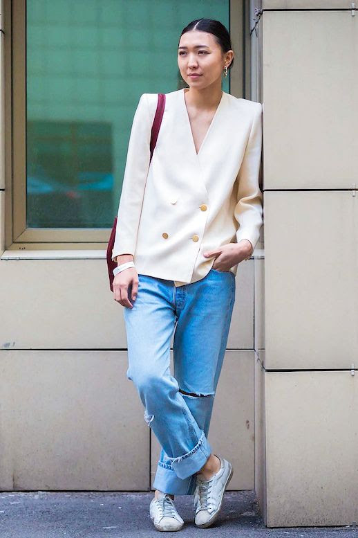 Le Fashion Blog Street Style Cream Blazer With Structured Shoulders And Gold Buttons Slouchy Boyfriend Jeans White Sneakers Red Bag Via Vogue