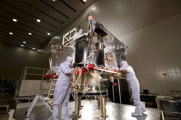 At the Lockheed Martin facility in Littleton, Colorado, engineers work on the OSIRIS-REx spacecraft after its core structure was combined with its hydrazine fuel tank and boat tail assembly.