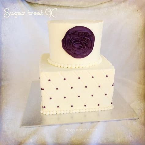2 tier wedding cake. Square and round diamond pattern and