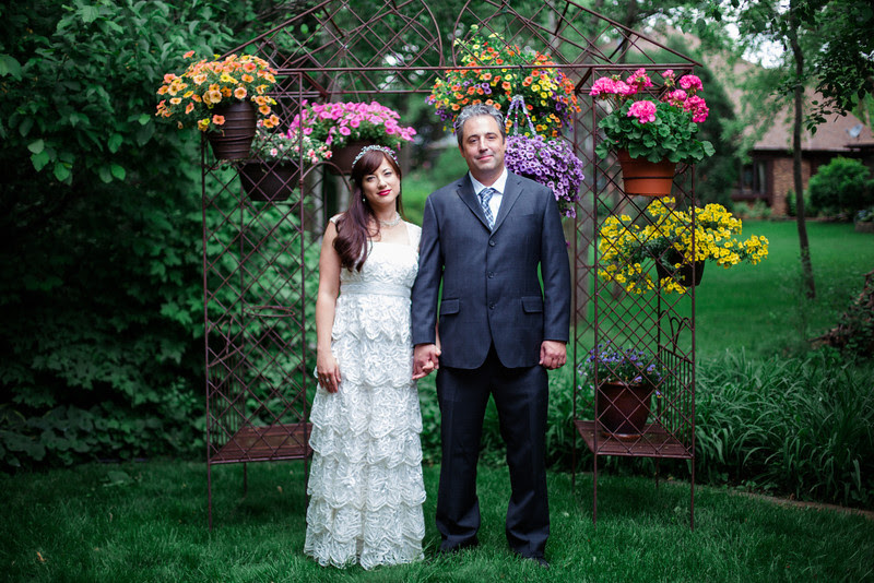 Bride and Groom Portraits following a small summer garden wedding ceremony in Rockford IL by Mindy Joy Photography