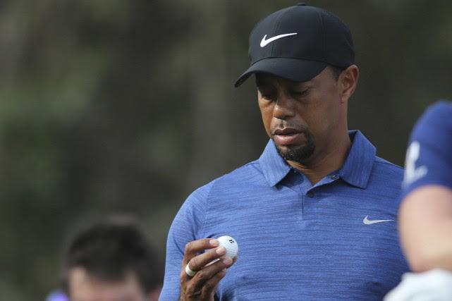 Tiger Woodss'est retiré avant de prendre le départ... (Photo Kamran Jebreili, AP)