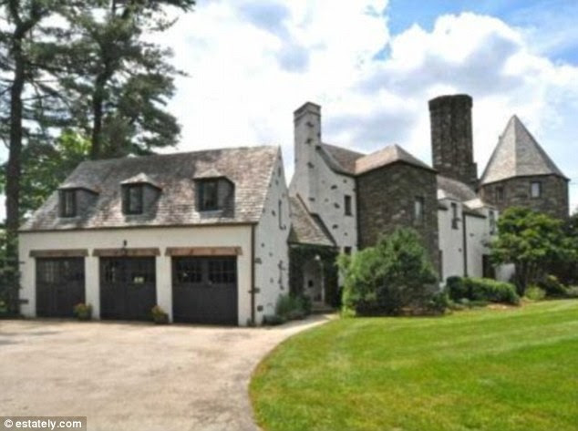 Garden palace: This six-bedroom home in Flourtown, Pennsylvania featuring angled ceilings and winding staircases is listed for $1,895,000