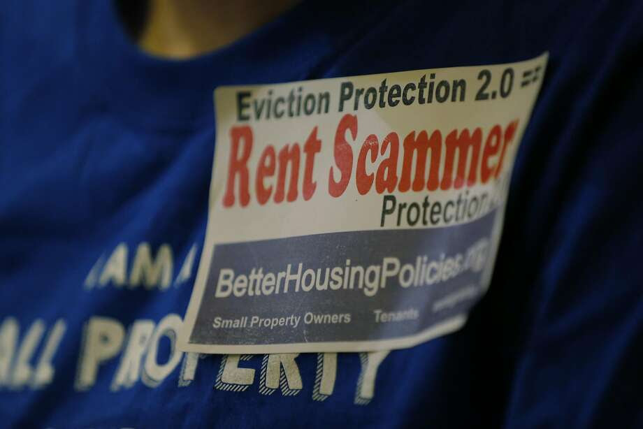 A sticker on the shirt of an opponent of new eviction protection legislation at a San Francisco Board of Supervisors meeting at City Hall in San Francisco, California, on Tuesday, Sept. 22, 2015. Photo: Connor Radnovich, The Chronicle