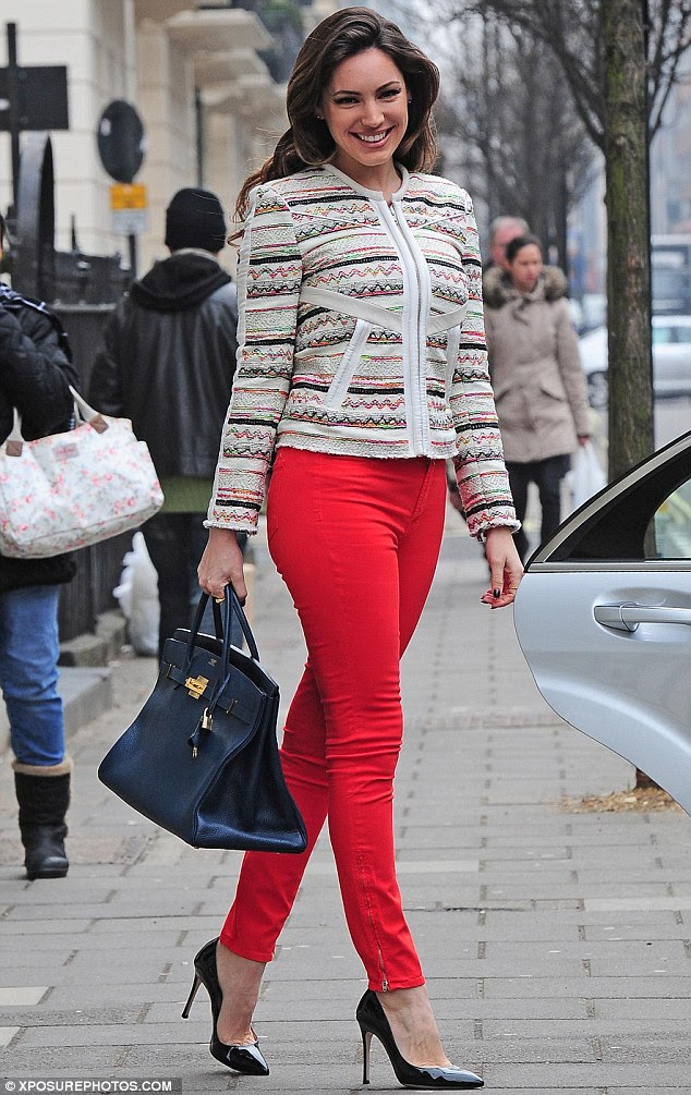Red hot! Kelly Brook cut a stylish figure as she stepped out in a pair of skintight scarlet jeans on Wednesday afternoon