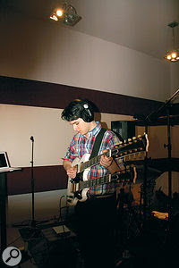 Ezra Koenig playing the double‑necked Gibson SG that provided many of the guitar parts on 'Cousins'.