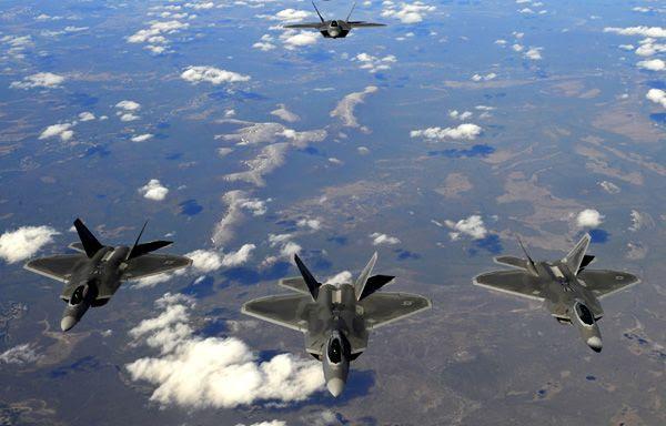 A squad of F-22 Raptors fly over Alaska.