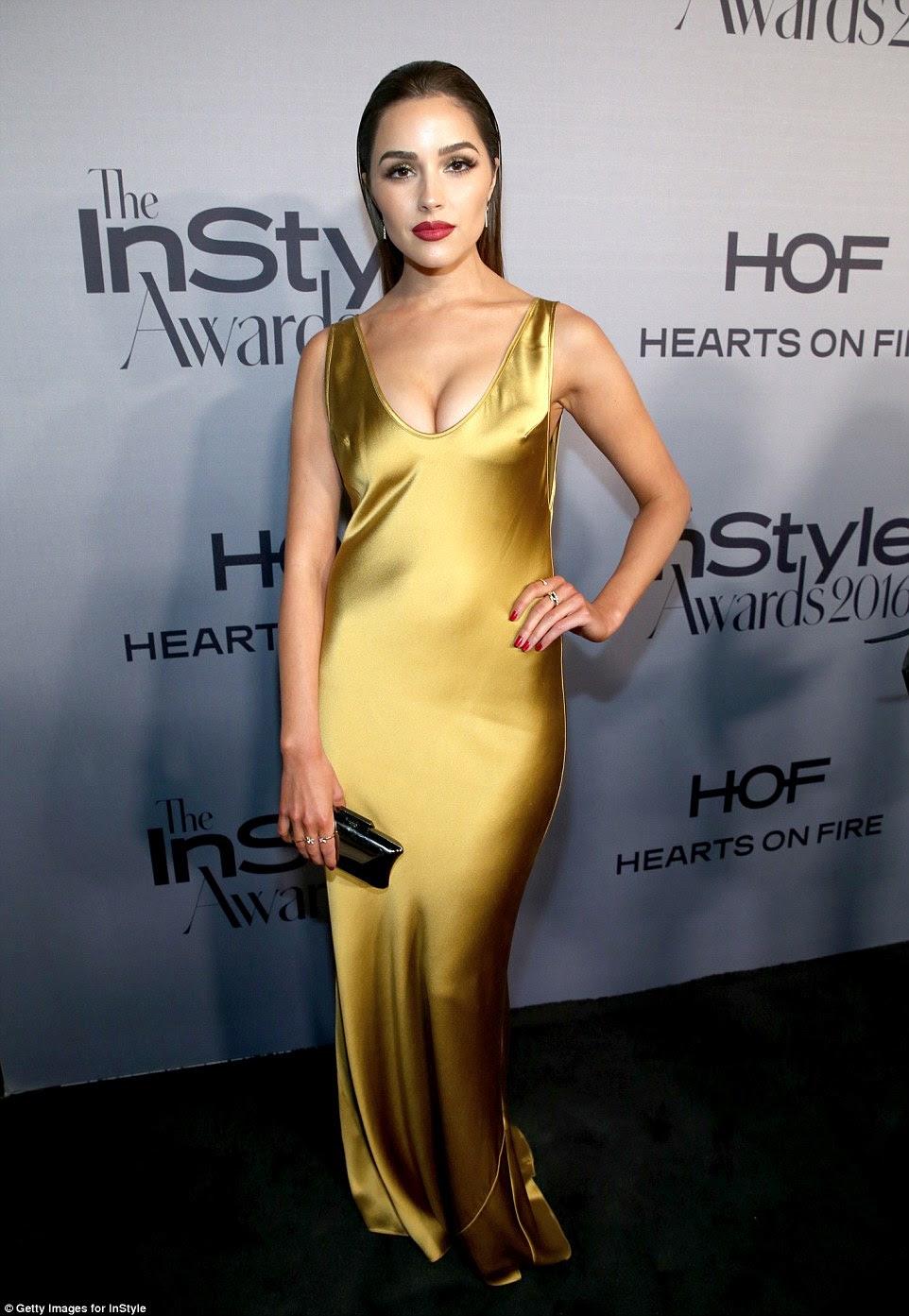 Elegante: vestido de Olivia sentou-se perfeitamente em sua figura sensacional