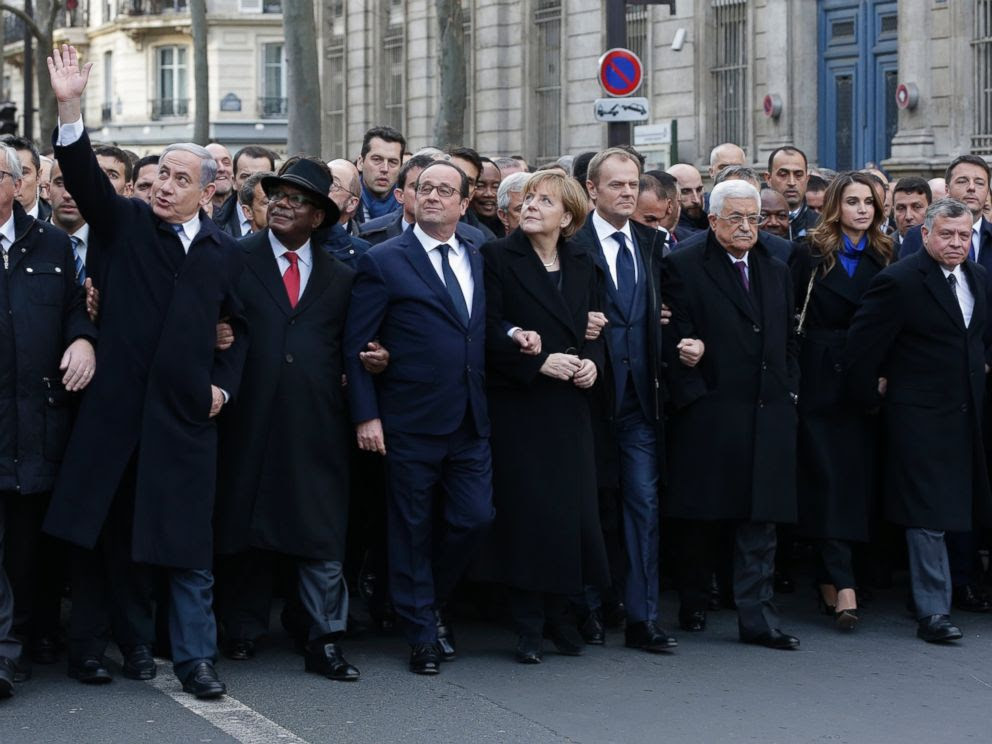 PHOTO: French President Francois Hollande is surrounded by head of states as they attend the solidarity march (Marche Republicaine) in the streets of Paris, Jan. 11, 2015.