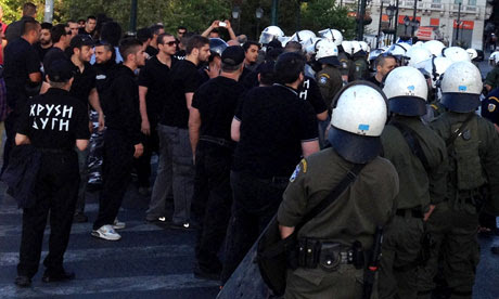 Police confront Golden Dawn party members at a food giveaway in Athens