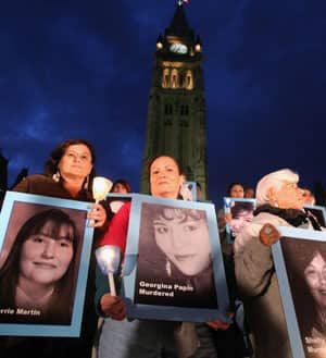 A candle light vigil for missing or murdered aboriginal women on Parliament Hill in Ottawa on Oct. 4, 2009. A report released in April 2010, added 62 more names to a growing list of missing or slain aboriginal women and girls across Canada.