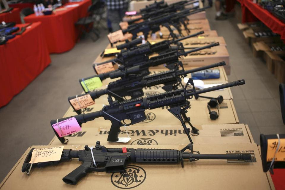 FILE -- Smith & Wesson AR-15 rifles for sale at a gun show in Loveland, Colo., Oct. 11, 2014. The military-style gun, a version of which was used in the Pulse night club mass shooting that left 50 dead on June 12, 2016, has become, simultaneously, one of most beloved and most vilified rifles in the country. (Luke Sharrett/The New York Times)