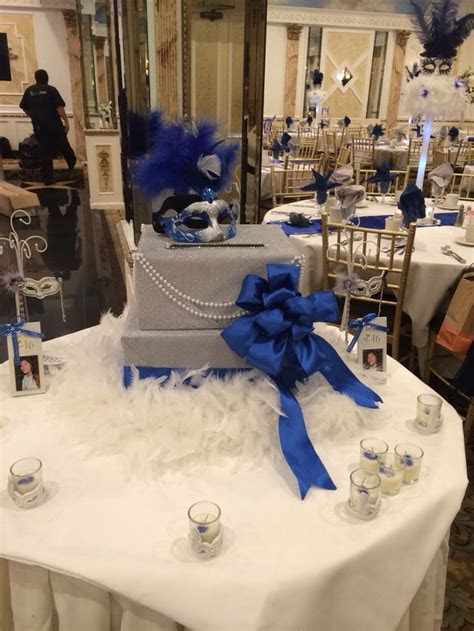 Masquerade theme card box . Royal blue, silver . Feathers