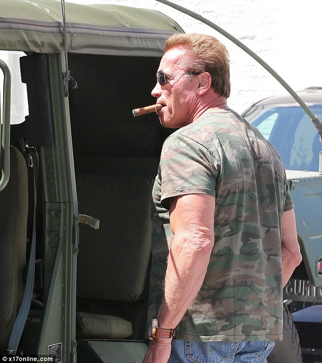 He'll be back: The 67-year-old was wearing jeans and a green camouflage T-shirt that showed off his bulging biceps