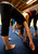 Kate Hutchinson of Oakland, Calif., left, and Lauren Korshak of San Francisco use their own body weight to work together on a stretching drill during an acro yoga class -- a combination of acrobatics and yoga -- Monday, Sept. 23, 2013 in Emeryville, Calif. (D. Ross Cameron/Bay Area News Group)
