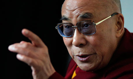 Tibet's exiled spiritual leader the Dalai Lama answers questions at a news conference in Manchester