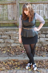 Layered outfit: black gingham flannel shirt, leather peplum top, thrifted black mini skirt, black tights, black and white saddle oxfords
