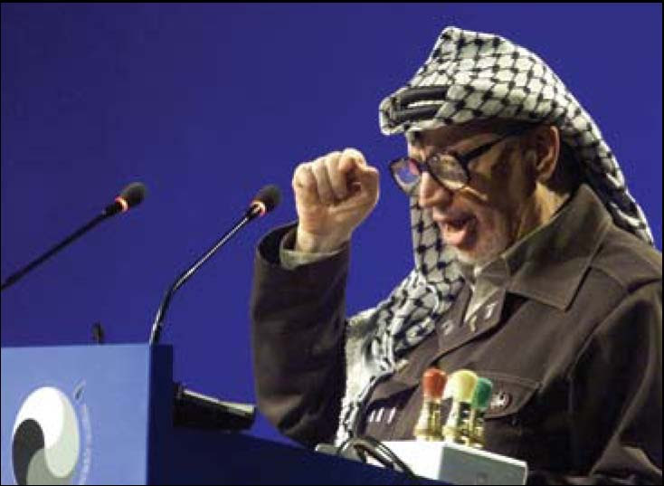 Palestinian leader Yasser Arafat on September 1, 2001, at the World Conference Against Racism in Durban, South Africa. Arafat and his nephew, Palestine's UN delegate Nasser al-Kidwa,  led Durban's campaign to delegitimize, demonize, and isolate the State of Israel.
