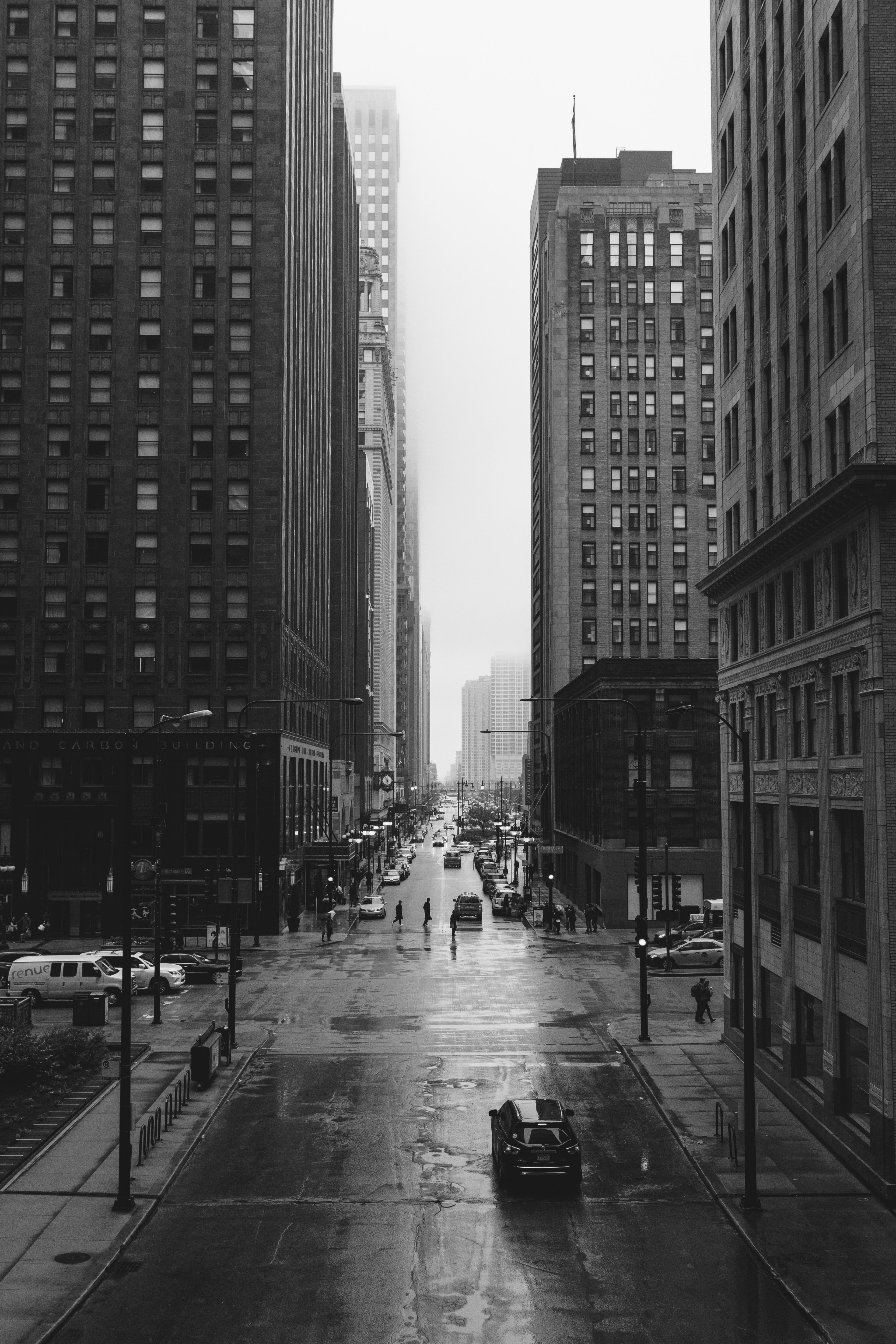 A Black And White Shot Of The Streets Of Chicago On A Rainy