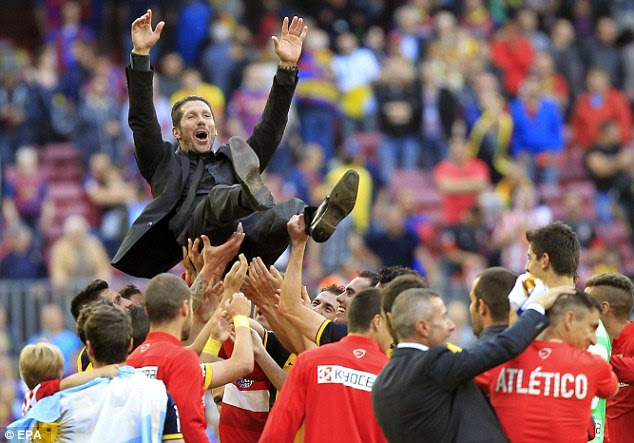 Atletico Madrid manager Diego Simeone is hoisted in the air after their 1-1 draw at Barcelona secured the title at the Nou Camp back in 2014