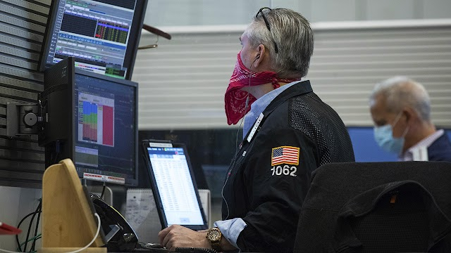Stock futures rise as investors study earnings reports