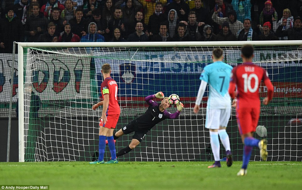 Slovenia came very close to opening the scoring when Jasmin Kurtic saw his early effort cannon back off Joe Hart's post