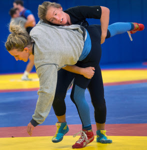 Deanna Betterman, top, practices takedowns with Haley Augello during practice Tuesday at the Olympic Training Center in Colorado. The Gazette/Christian Murdock/Special to the Press Herald