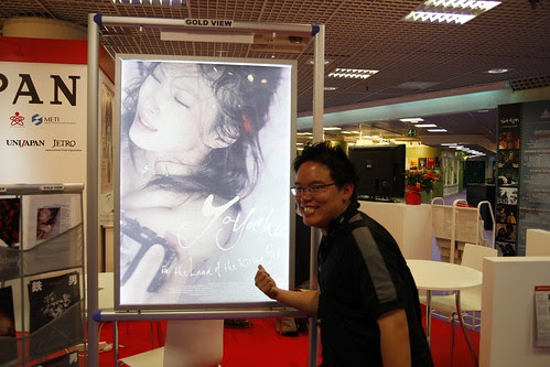 Me and a poster of a documentary about a pornographer