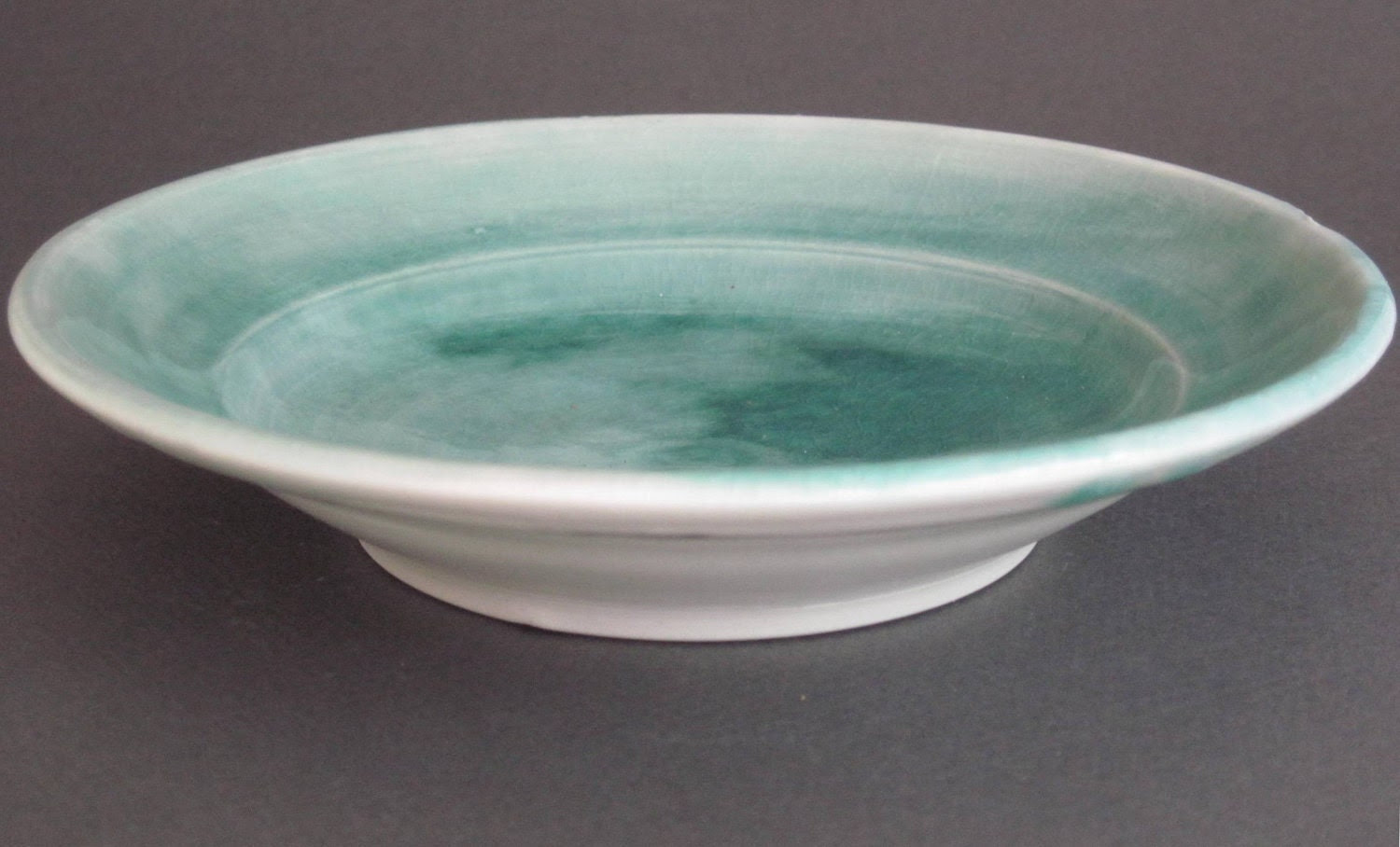 small plate with turquoise glaze and black line (018)