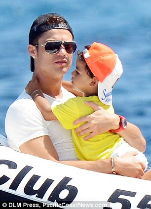 Didn't shirk on childcare: Cristiano was seen carrying his son around during the day