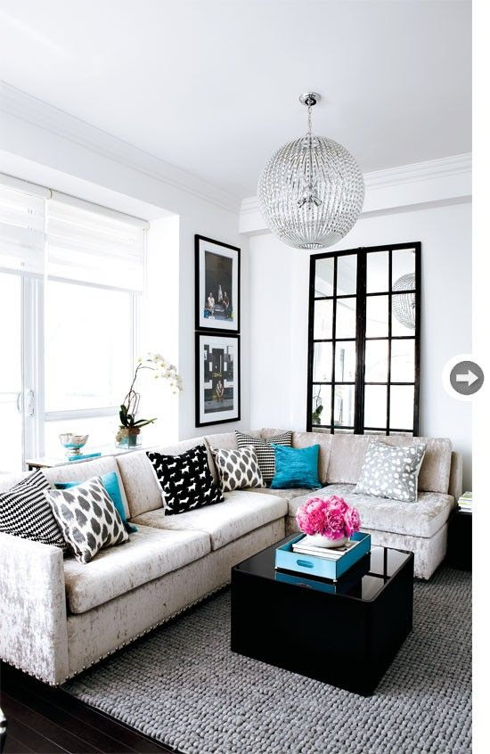 Teal and grey living room.  Liking the sectional... shows the impact of a great floor mirror.  So open!
