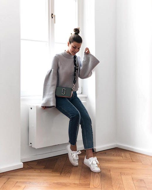 Le Fashion Blog Balloon Sleeve Gray Sweater Two Tone Cropped Jeans White Bow Sneakers Via @fashiioncarpet