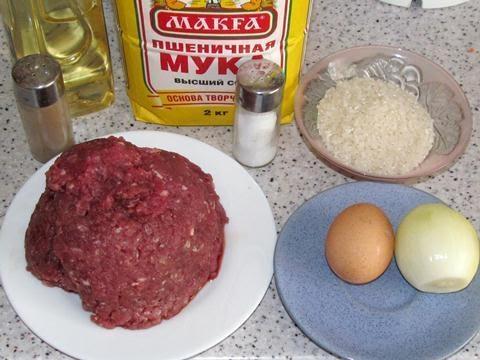Фото к рецепту: Ёжики из фарша с рисом.