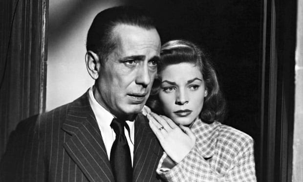Humphrey Bogart as Philip Marlowe with Lauren Bacall in The Big Sleep.