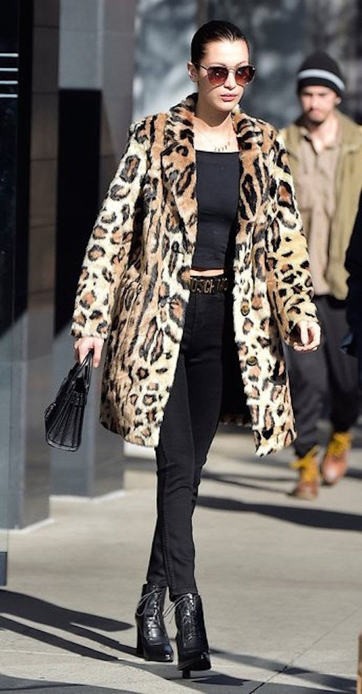 Le Fashion Blog Bella Hadid Sunglasses Leopard Coat Black Shirt Black Skinny Jeans Heeled Boots Via Vogue