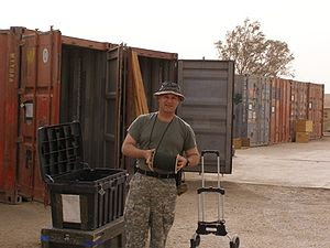 """GI loads a shipping container. """"On the 18..."""