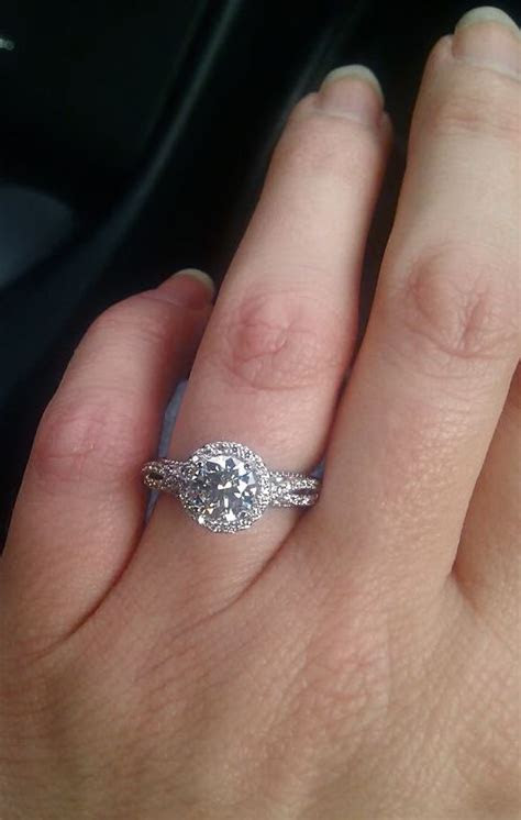 My engagement ring on my hand = one proud, happy, excited