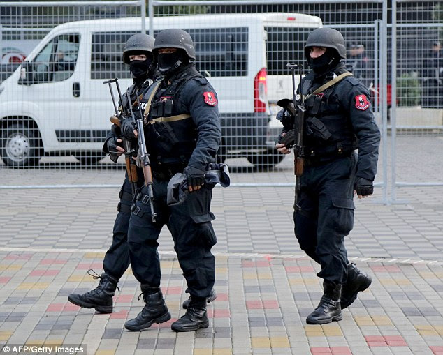 Albanian special policemen patrol at the Elbasan Arena stadium on Saturday, after the match was moved because of security concerns