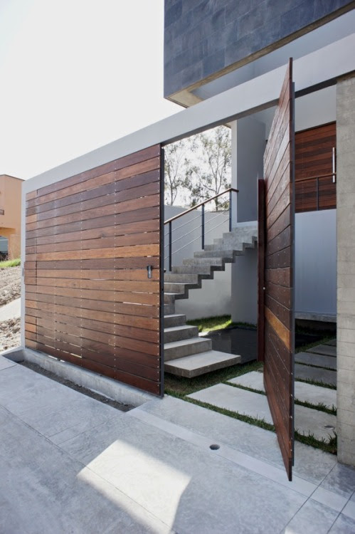 PH3 House by T38 studio Closing itself to the street for privacy, the back of the house opens itself to the patio, creating indoor/outdoor living space.