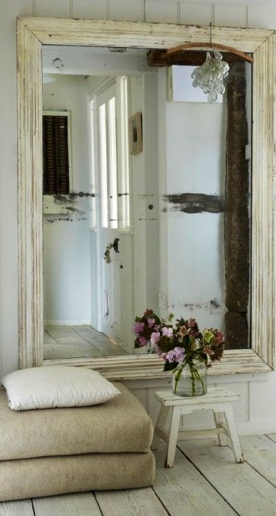LOVE a HUUUGE mirror......I went with black frames. &....a few gold ornate frames......but BIG always looks right..........