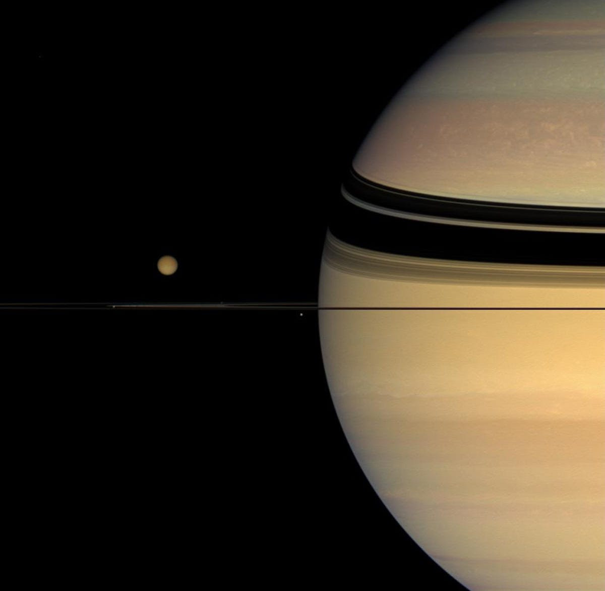 Titan, Saturn's largest moon (left), is the size of planet Mercury. Cassini used its gravity to change its orbit and visit targets of interest.