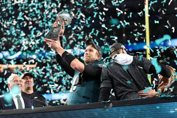 Nick Foles hoists the Vince Lombardi trophy after his Philadelphia Eagles defeat the New England Patriots, 41-33, in Super Bowl 52...on February 4, 2018.