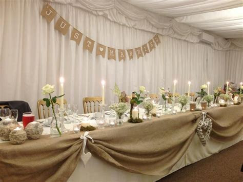 Wedding meal top table rustic marquee ivory natural